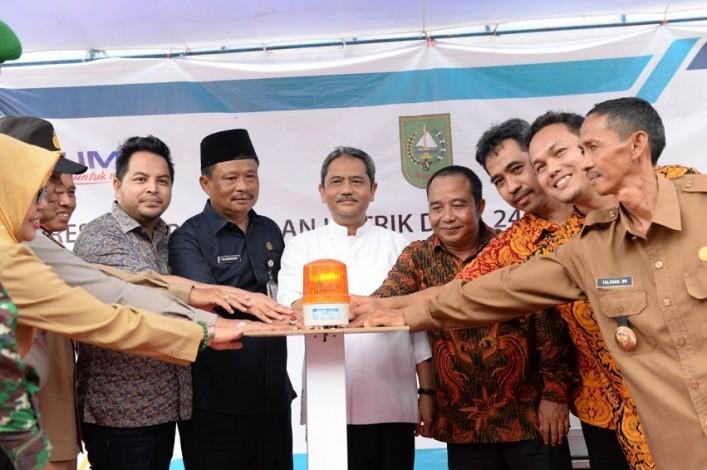 Sekdaprov Resmikan Pelayanan Listrik Desa se Riau
